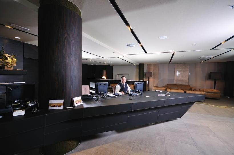 reception service man hotel indoor smile travel
